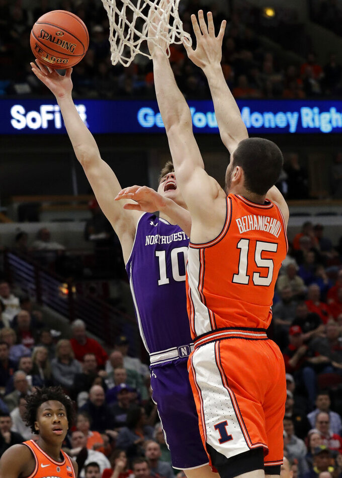 Northwestern forward Miller Kopp, left, shoots against Illinois forward Giorgi Bezhanishvili during the first half of an NCAA college basketball game in the first round of the Big Ten Conference tournament in Chicago, Wednesday, March 13, 2019. (AP Photo/Nam Y. Huh)