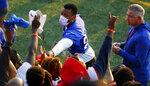 New York Giants' Saquon Barkley signs autographs for fans following the team's NFL training camp at Eddie Moraes Stadium, Saturday, July 31, 2021, in Newark, N.J. (AP Photo/John Munson)