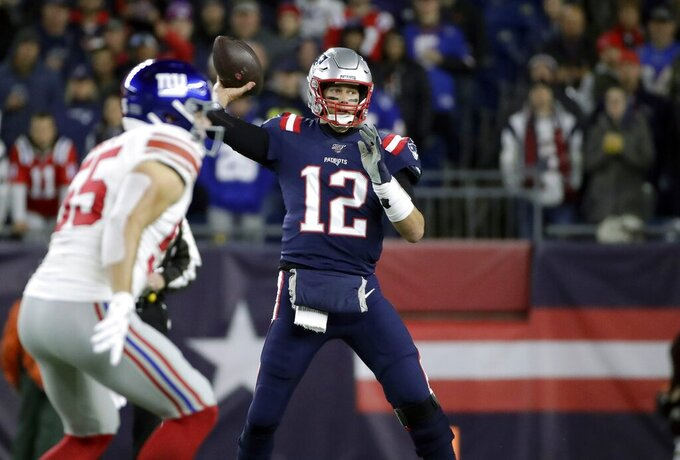 New England Patriots quarterback Tom Brady throws his first pass of the game against the New York Giants in the first half of an NFL football game, Thursday, Oct. 10, 2019, in Foxborough, Mass. The completion gave Brady the second most total passing yards in NFL history. (AP Photo/Elise Amendola)