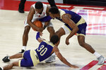 Houston guard Jamal Shead, top left, and Alcorn State guards Myson Lowe (30) and Tajah Fraley fight for the ball during the second half of an NCAA college basketball game, Sunday, Dec. 20, 2020, in Houston. (AP Photo/Eric Christian Smith)