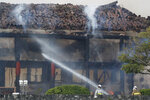Firefighters try to extinguish a fire at the north hall of Shuri Castle in Naha, Okinawa, southern Japan, Thursday, Oct. 31, 2019. A fire spread among structures at Shuri Castle on Japan's southern island of Okinawa, nearly destroying the UNESCO World Heritage site. (Jun Hirata/Kyodo News via AP)
