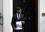 Britain's Chancellor of the Exchequer Rishi Sunak poses for photographers outside No 11 Downing Street, before heading for the House of Commons to give MPs details of his Winter Economy Plan, in London, Thursday Sept. 24, 2020. (AP Photo/Frank Augstein)