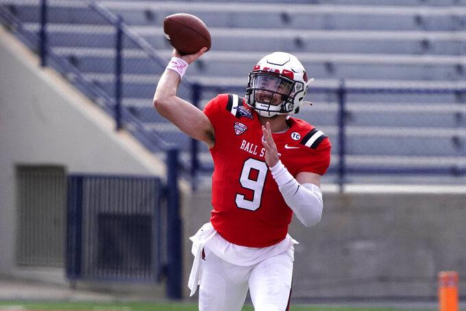 Ball State quarterback Drew Plitt (9) throws downfield against San Jose State in the first half of the Arizona Bowl NCAA college football game, Thursday, Dec. 31, 2020, in Tucson, Ariz. (AP Photo/Rick Scuteri)