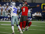 Dallas Cowboys' Chris Westry (39), Tampa Bay Buccaneers kicker Matt Gay (9) and Bradley Pinion, rear, watch the successful field goal kick by Gay in the second half of a preseason NFL football game in Arlington, Texas, Thursday, Aug. 29, 2019. (AP Photo/Michael Ainsworth)