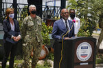 Haitian Prime Minister Ariel Henry speaks during a joint press conference with USAID and SOUTHCOM at the international airport in Port-au-Prince, Haiti,Thursday, Aug. 26, 2021, weeks after the 7.2 magnitude earthquake. At left are USAID Administrator Samantha Power and SOUTHCOM Commander Admiral Faller. (AP Photo/Joseph Odelyn)
