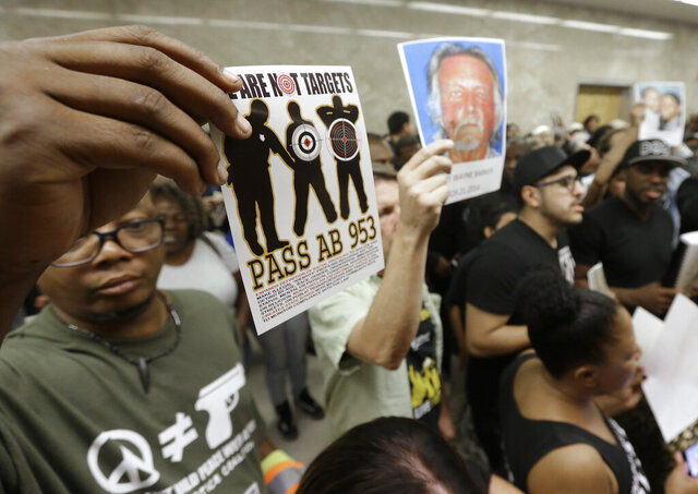FILE - In this Sept. 2, 2015 file photo protestors shouting