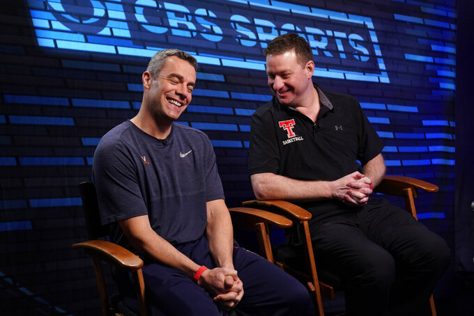 "Virginia head coach Tony Bennett, left, and Texas Tech head coach Chris Beard talk as they arrive at an interview for CBS Sports Network's ""We Need to Talk"" show before the championship game of the Final Four NCAA college basketball tournament, Sunday, April 7, 2019, in Minneapolis. (AP Photo/David J. Phillip)"