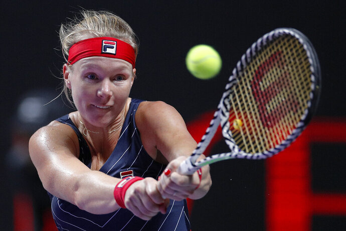 Kiki Bertens of the Netherlands hits a return shot to Ashleigh Barty of Australia during their WTA Finals Tennis Tournament in Shenzhen, China's Guangdong province, Tuesday, Oct. 29, 2019. (AP Photo/Andy Wong)