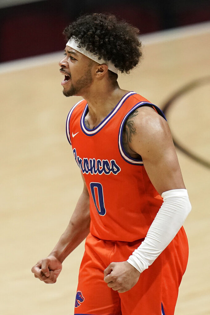 Boise State guard Marcus Shaver Jr. (0) reacts after a team mate scored three points during the second half of an NCAA college basketball game against the San Diego State Saturday, Feb 27, 2021, in San Diego. (AP Photo/Gregory Bull)