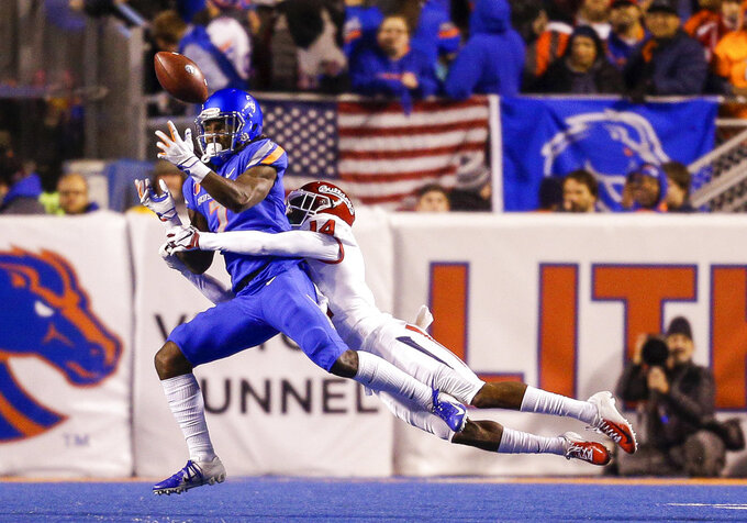 Boise State wide receiver A.J. Richardson (7) has the ball knocked out of his hands by Fresno State defensive back Jaron Bryant (14) during the first half of an NCAA college football game Friday, Nov. 9, 2018, in Boise, Idaho. (AP Photo/Steve Conner)