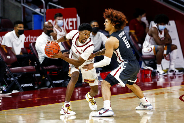 Southern California guard Tahj Eaddy, left, is defended by Washington State guard Isaac Bonton during the second half of an NCAA college basketball game Saturday, Jan. 16, 2021, in Los Angeles. (AP Photo/Ringo H.W. Chiu)
