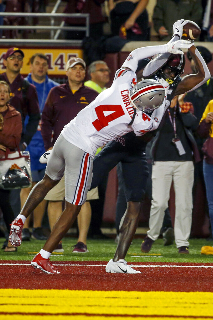 Minnesota wide receiver Dylan Wright, top right, hauls down a pass over Ohio State cornerback Lejond Cavazos (4) for a touchdown in the second quarter of an NCAA college football game Thursday, Sept. 2, 2021, in Minneapolis. (AP Photo/Bruce Kluckhohn)