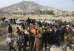 FILE - In this Jan. 28, 2018 file photo, mourners carry the coffin of a relative who died in a deadly attack a day earlier that killed over 100 people, in Kabul, Afghanistan. Peace in Afghanistan seems even more elusive, both for troops on the front lines of this war-battered country and for survivors of countless attacks, since the Taliban shrugged off the government's latest offers of cease-fire and negotiations. (AP Photo/Rahmat Gul, File)