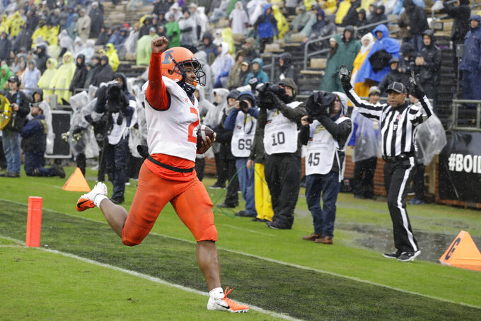 Illinois running back Reggie Corbin (2) reacts after running for a touchdown during the second half of an NCAA college football game against Purdue, Saturday, Oct. 26, 2019, in West Lafayette, Ind. (AP Photo/Darron Cummings)