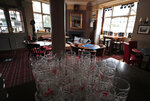 Glasses on display as tables are rearranged ensuring social distancing at the Chandos Arms pub in London, Wednesday, July 1, 2020. Asking people in English pubs to keep their distance is going to be tough after they've had a few of their favorite tipples. Pub managers will have to be resourceful come Saturday, July 4, 2020, when they and other parts of the hospitality industry in England open their doors to customers for the first time since March 20, provided they meet COVID safety requirements. (AP Photo/Frank Augstein)