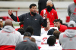 FILE - In this Oct. 3, 2020, file photo, Ohio State head coach Ryan Day talks to his team during their NCAA college football practice in Columbus, Ohio. No. 6 Ohio State has outsized expectations for the 2020 season after coming within one play of advancing to the national championship game last season. (AP Photo/Jay LaPrete, File)