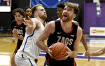 Gonzaga forward Drew Timme, right, drives to the basket on Portland forward Mikey Henn, left, during the first half of an NCAA college basketball game in Portland, Ore., Saturday, Jan. 9, 2021. (AP Photo/Steve Dykes)