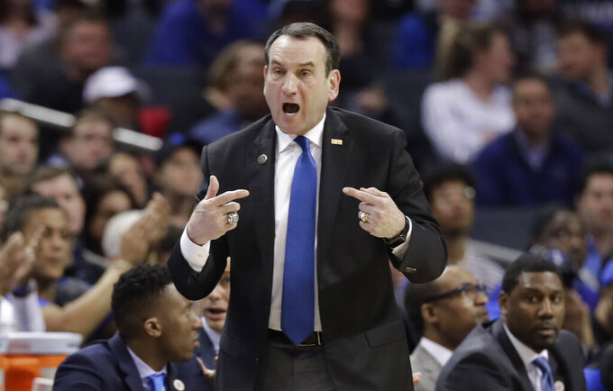 Duke head coach Mike Krzyzewski directs his team against North Carolina during the first half of an NCAA college basketball game in the Atlantic Coast Conference tournament in Charlotte, N.C., Friday, March 15, 2019. (AP Photo/Chuck Burton)