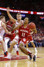 Indiana's Devonte Green (11) drives against Wisconsin's Brad Davison (34) during the first half of an NCAA college basketball game Saturday, Dec. 7, 2019, in Madison, Wis. (AP Photo/Andy Manis)