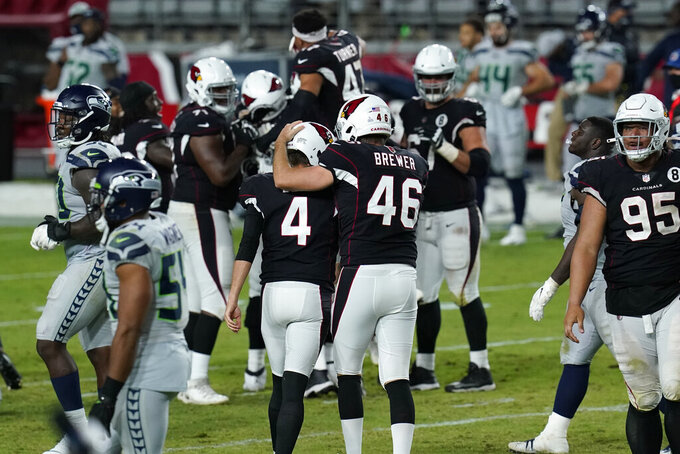 Arizona Cardinals kicker Zane Gonzalez (5) celebrates with long snapper Aaron Brewer (46) after kicking the game winning field goal during the second half of an NFL football game against the Seattle Seahawks, Sunday, Oct. 25, 2020, in Glendale, Ariz. The Cardinals won 37-34 in overtime. (AP Photo/Ross D. Franklin)