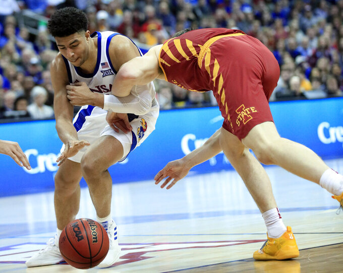 Kansas guard Quentin Grimes, left, steals the ball from Iowa State forward Michael Jacobson, right, during the second half of an NCAA college basketball game in the final of the Big 12 men's tournament in Kansas City, Mo., Saturday, March 16, 2019. (AP Photo/Orlin Wagner)