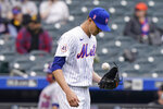 New York Mets starting pitcher Jacob deGrom tosses the ball during the fifth inning of a baseball game against the Arizona Diamondbacks, Sunday, May 9, 2021, in New York. deGrom left the game in the sixth inning after throwing only two warmup pitches. (AP Photo/Kathy Willens)