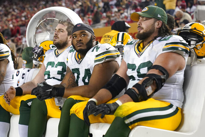 Green Bay Packers center Corey Linsley, from left, sits on the bench with offensive guard Elgton Jenkins and offensive tackle David Bakhtiari during the second half of the NFL NFC Championship football game against the San Francisco 49ers Sunday, Jan. 19, 2020, in Santa Clara, Calif. The 49ers won 37-20 to advance to Super Bowl 54 against the Kansas City Chiefs. (AP Photo/Tony Avelar)
