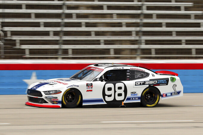 NASCAR Xfinity Series driver Chase Briscoe (98) comes out of turn four onto the front stretch during a NASCAR Xfinity Series auto race at Texas Motor Speedway in Fort Worth, Texas, Saturday Oct. 24, 2020. (AP Photo/Richard W. Rodriguez)