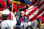 World War II Army Veteran Russell Noss, looks to the American Flag with his hand over his heart as Taps is played at the World War II Memorial on the National Mall in Washington, Friday, May 24, 2019. (AP Photo/Carolyn Kaster)