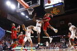 Texas Tech forward TJ Holyfield (22) blocks a shot by Iowa State guard Terrence Lewis (24) during the first half of an NCAA college basketball game Saturday, Feb. 22, 2020, in Ames, Iowa. (AP Photo/Charlie Neibergall)