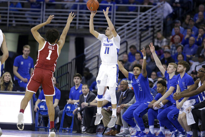 "FILE - Creighton's Marcus Zegarowski (11) shoots for three points against Oklahoma's Jalen Hill (1) during the second half of an NCAA college basketball game in Omaha, Neb., in this Tuesday, Dec. 17, 2019, file photo. Zegarowski announced he's leaving Creighton and declaring for the NBA draft, the biggest name in an exodus that started after the Bluejays' run to the NCAA Sweet 16. ""I will be entering the 2021 NBA draft and look forward to continuing to work hard, chase my dreams and play the game I love,"" Zegarowski tweeted Tuesday, April 13, 2021. ""Thank you Creighton for making my college experience so special. I will forever be a Bluejay."" (AP Photo/Nati Harnik, File)"
