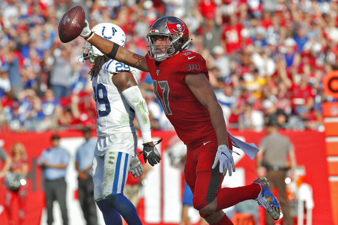Tampa Bay Buccaneers wide receiver Justin Watson (17) celebrates his 17-yard touchdown reception in front of Indianapolis Colts free safety Malik Hooker (29) during the second half of an NFL football game Sunday, Dec. 8, 2019, in Tampa, Fla. (AP Photo/Mark LoMoglio)