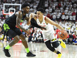 Maryland guard Anthony Cowan Jr. (1) drives to the basket against Michigan State guard Rocket Watts (2) during the second half of an NCAA college basketball game Saturday, Feb. 29, 2020, in College Park, Md. (AP Photo/Terrance Williams)