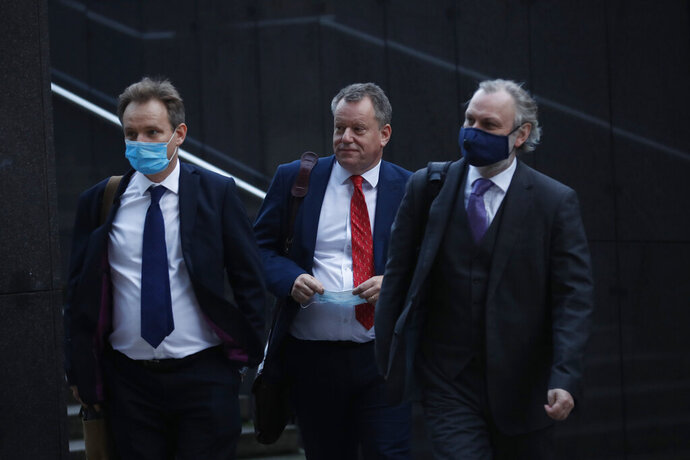 British Brexit negotiator David Frost, center, and Britain's Ambassador to the European Union Tim Barrow, right, arrive for a meeting with European Commission's Head of Task Force for Relations with the United Kingdom Michel Barnier at EU headquarters in Brussels, Monday, Oct. 12, 2020. (AP Photo/Francisco Seco)