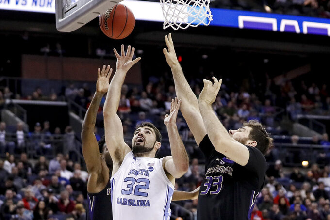 North Carolina's Luke Maye (32) shoots against Washington's Sam Timmins (33) during the second half of a second-round men's college basketball game in the NCAA Tournament, Sunday, March 24, 2019, in Columbus, Ohio. (AP Photo/John Minchillo)