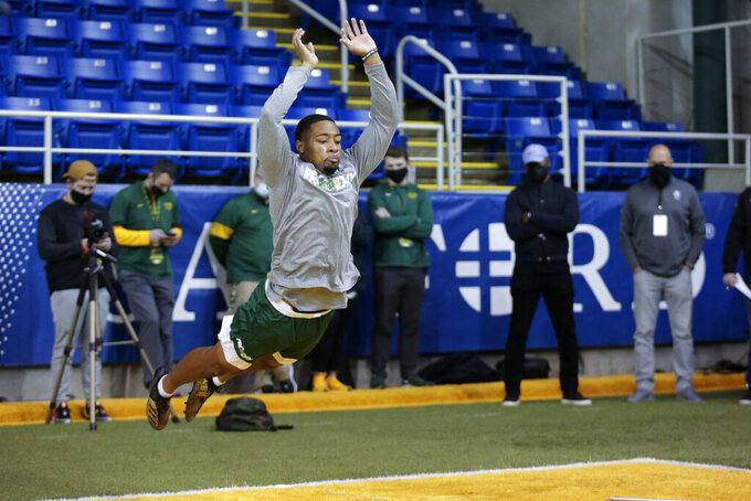 North Dakota State cornerback Marquise Bridges long jumps at the school's football NFL Pro Day Friday, March, 12, 2021, in Fargo, North Dakota. (AP Photo/Andy Clayton- King)