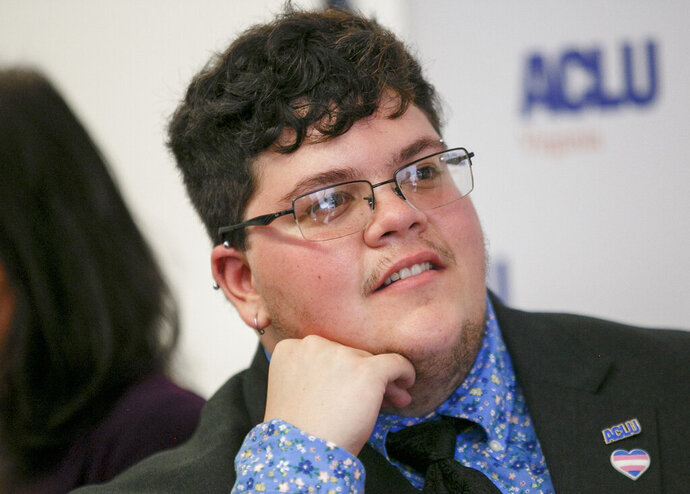 FILE - In this Tuesday, July 23, 2019, file photo, Gavin Grimm, who has become a national face for transgender students, speaks during a news conference held by The ACLU and the ACLU of Virginia at Slover Library in Norfolk, Va. A federal judge in Virginia ruled Friday, Aug. 9, 2019, that a school board's transgender bathroom ban discriminated against former student Grimm. (Kristen Zeis/The Daily Press via AP, File)