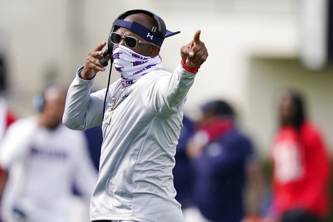 Jackson State football coach Deion Sanders gestures to his players during the first half of an NCAA college football game against Mississippi Valley State, Sunday, March 14, 2021, in Jackson, Miss. (AP Photo/Rogelio V. Solis)