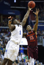 Duke forward Zion Williamson (1) and Virginia Tech guard Ahmed Hill (13) go after a rebound during the first half of an NCAA men's college basketball tournament East Region semifinal in Washington, Friday, March 29, 2019. (AP Photo/Alex Brandon)