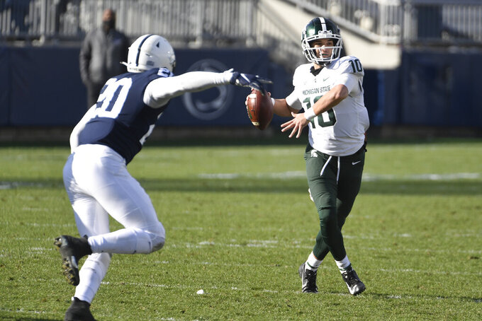 Michigan State quarterback Payton Thorne (10) throws a pass against Penn State during the second quarter of an NCAA college football game in State College, Pa., on Saturday, Dec. 12, 2020. (AP Photo/Barry Reeger)