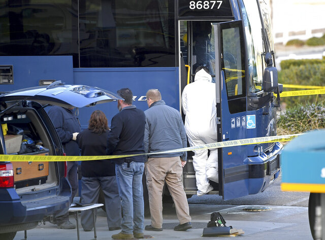 Investigators are seen outside of a Greyhound bus after a passenger was killed on board on Monday, Feb. 3, 2020 in Lebec, Calif. A gunman killed one passenger and wounded multiple others on a Greyhound bus traveling from Los Angeles to the San Francisco Bay Area early Monday morning, the California Highway Patrol said. (AP Photo/Jayne Kamin-Oncea)