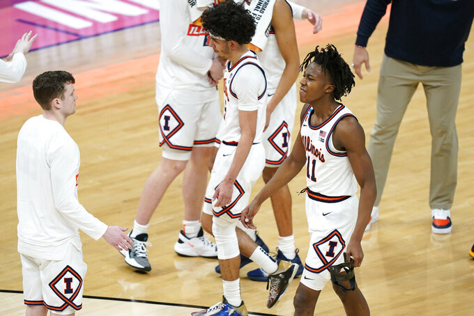 Illinois' Ayo Dosunmu (11) leaves the court after a college basketball game against Loyola in the second round of the NCAA tournament at Bankers Life Fieldhouse in Indianapolis Sunday, March 21, 2021. Loyola upset Illinois 71-58. (AP Photo/Mark Humphrey)