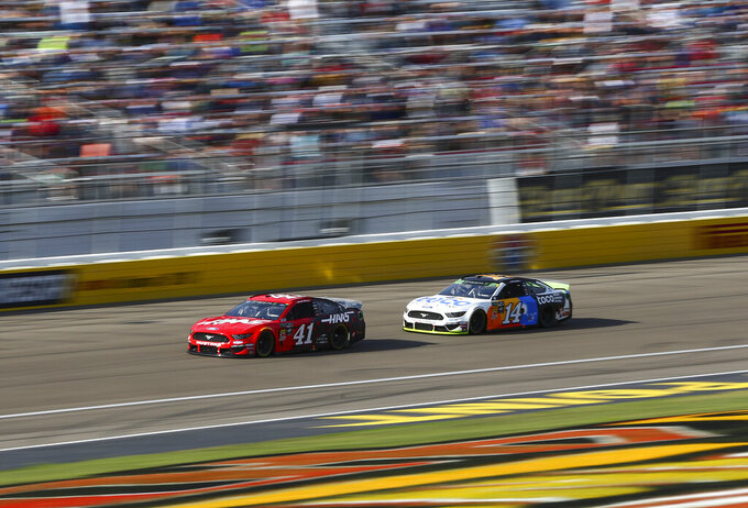 Daniel Suarez (41) and Clint Bowyer (14) drive during a NASCAR Cup Series auto race at Las Vegas Motor Speedway, Sunday, Sept. 15, 2019. (AP Photo/Chase Stevens)