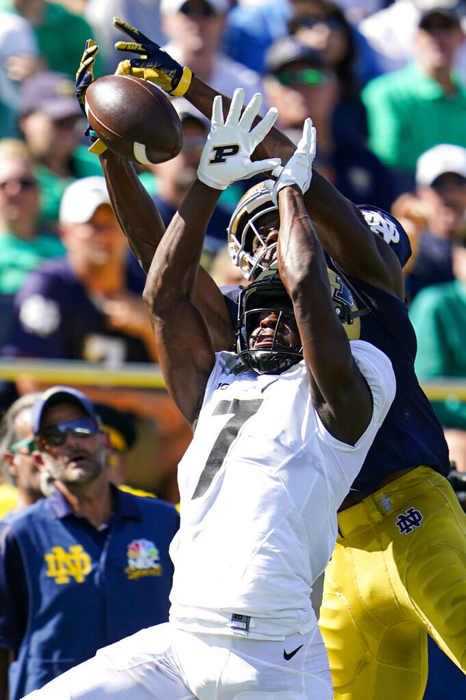 Notre Dame wide receiver Kevin Austin Jr. (4) attempts a catch over Purdue cornerback Jamari Brown (7) during the first half of an NCAA college football game in South Bend, Ind., Saturday, Sept. 18, 2021. Defensive interference was called on the play. (AP Photo/Michael Conroy)