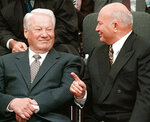 FILE - In this Wednesday, Sept. 2, 1998 file photo, Russian President Boris Yeltsin, left, smiles next to Moscow mayor Yuri Luzhkov during the opening ceremony of a memorial synagogue on Poklonnaya Hill in Moscow. The former mayor of Moscow and one of the founders of Russia's ruling United Russia party, Yuri Luzhkov, has died at the age of 83.  Russia's Ren TV channel reported Tuesday Dec. 10, 2019, that Luzhkov died in Munich, where he was undergoing heart surgery. (Sputnik, Kremlin Pool Photo via AP, File)