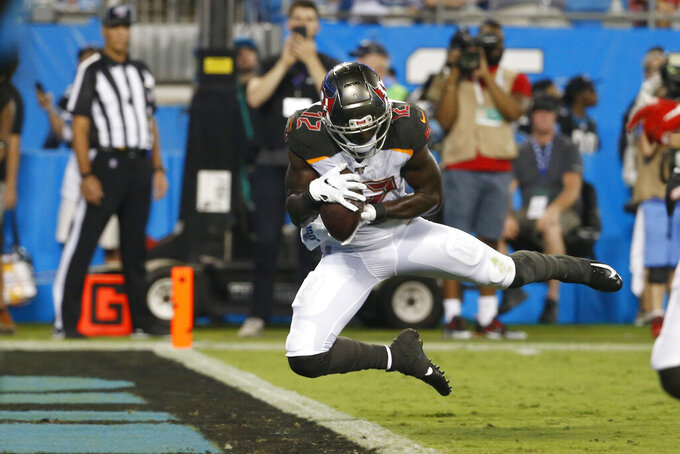FILE - In this Sept. 12, 2019, file photo, Tampa Bay Buccaneers wide receiver Chris Godwin (12) catches a touchdown pass during the first half of an NFL football game against the Carolina Panthers in Charlotte, N.C. Godwin has emerged as a star of his own this year. He has 54 catches for 766 yards and six touchdowns, nearly surpassing his season-long total in 2018. (AP Photo/Brian Blanco, File)