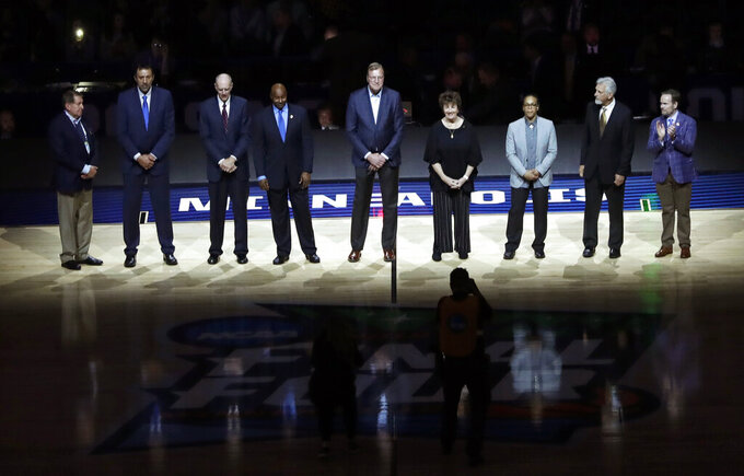 Members of the Naismith Memorial Basketball Hall of Fame Class of 2019 are introduced during halftime of a semifinal game between Auburn and Virginia in the Final Four NCAA college basketball tournament, Saturday, April 6, 2019, in Minneapolis. (AP Photo/Matt York)