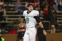 Marshall quarterback Grant Wells takes the field as the Herd prepares to take on Western Kentucky in an NCAA college football game Saturday, Oct. 10, 2020, in Huntington, W.Va. (Sholten Singer/The Herald-Dispatch via AP)