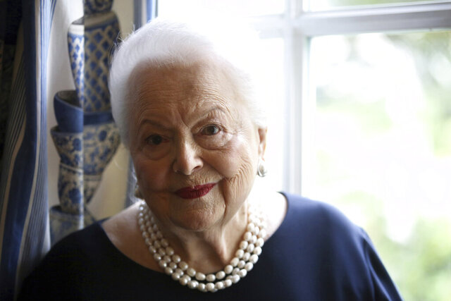 FILE - In this June 18, 2016, file photo, U.S. actress Olivia de Havilland poses during an Associated Press interview, in Paris. Olivia de Havilland, Oscar-winning actress has died, aged 104 in Paris,  publicist says Sunday July 26, 2020. (AP Photo/Thibault Camus, File)
