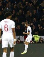 England's Harry Kane celebrates after scoring his side's second goal during the Euro 2020 group A qualifying soccer match between Kosovo and England at Fadil Vokrri stadium in Pristina, Kosovo, Sunday, Nov. 17, 2019. (AP Photo/Boris Grdanoski)